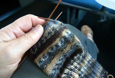 KnittingOnTheTrain.jpg